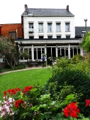 Talbot House - a place of recreation for soldiers, with a large garden, chapel, kitchen and concert hall.