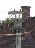 Biddenden town sign, with the famous conjoined twins, the Maids of Biddenden